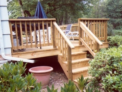 Installation of a deck attached to back of the house. This deck has stairs leading to backyard from home's living room.