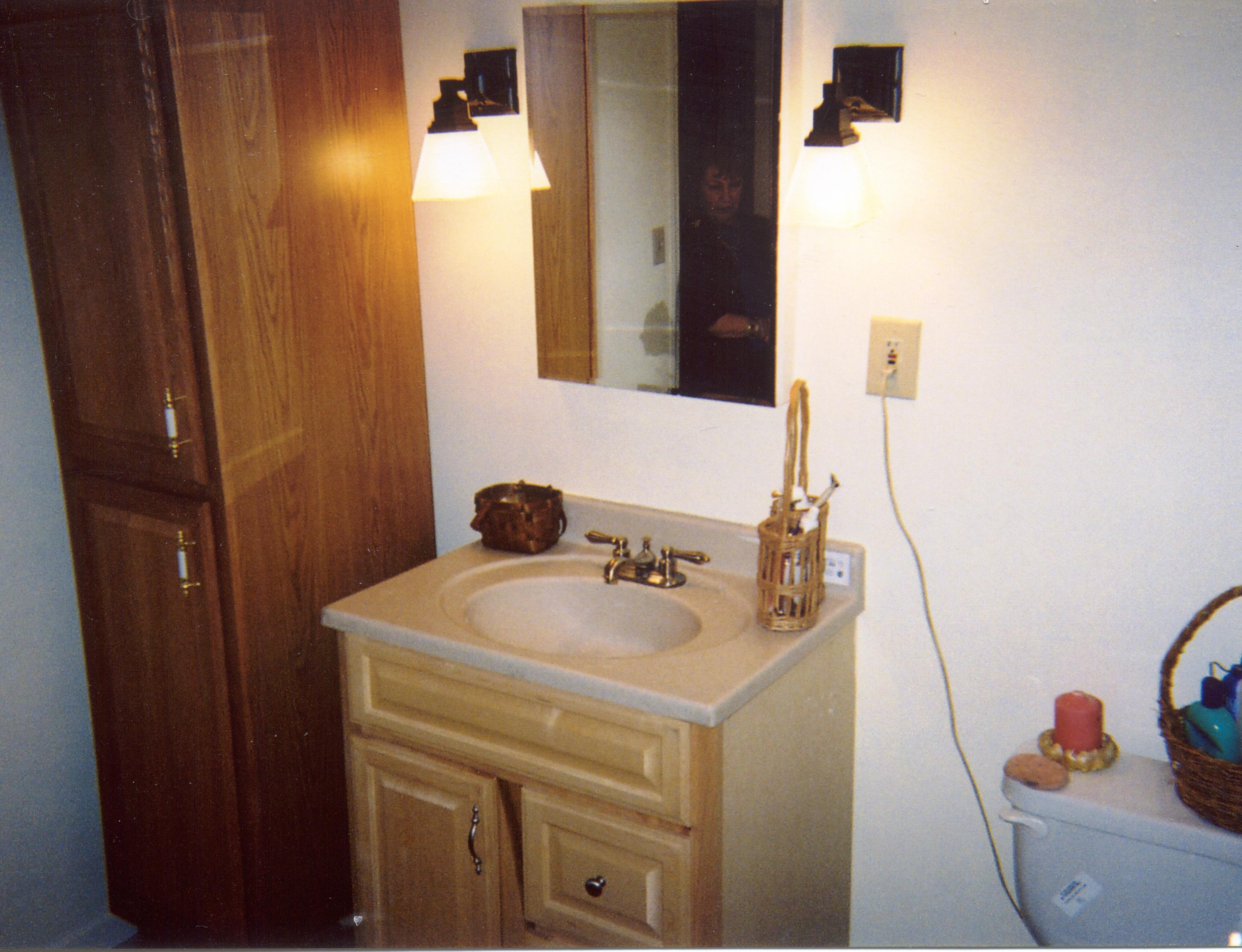 Bathroom remodeling with tub, vanity and toilet.