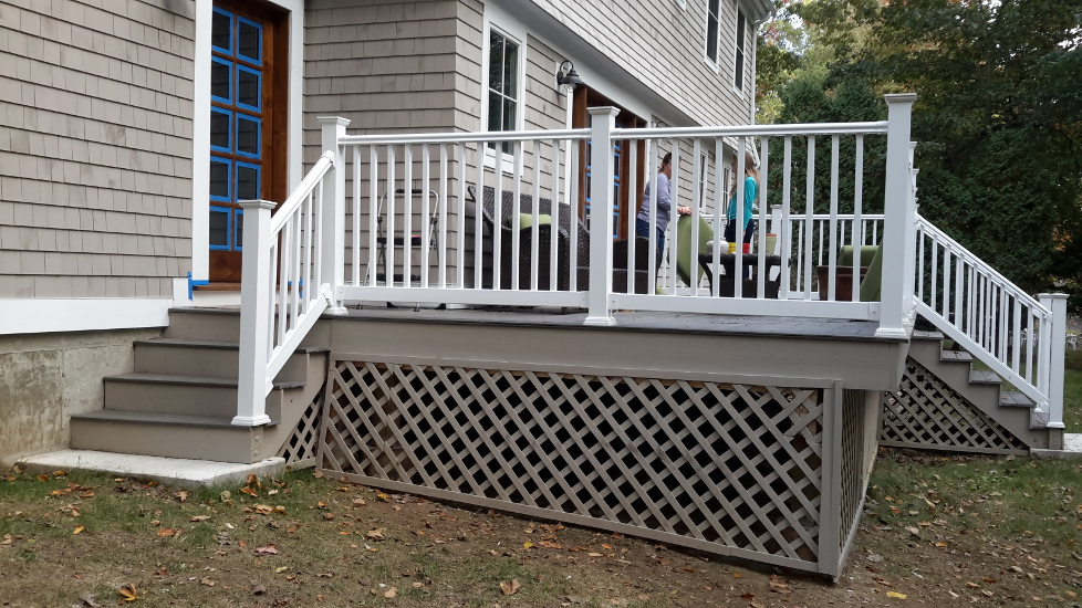 Deck addition with stairs, composite decking, railings and lattice work