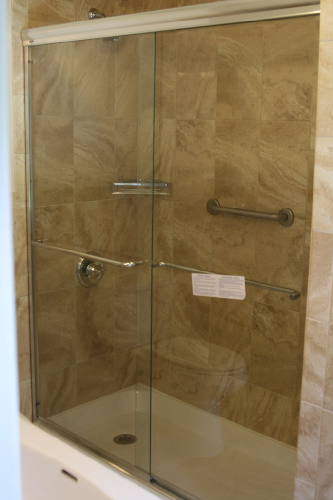 Shower surround with glass door