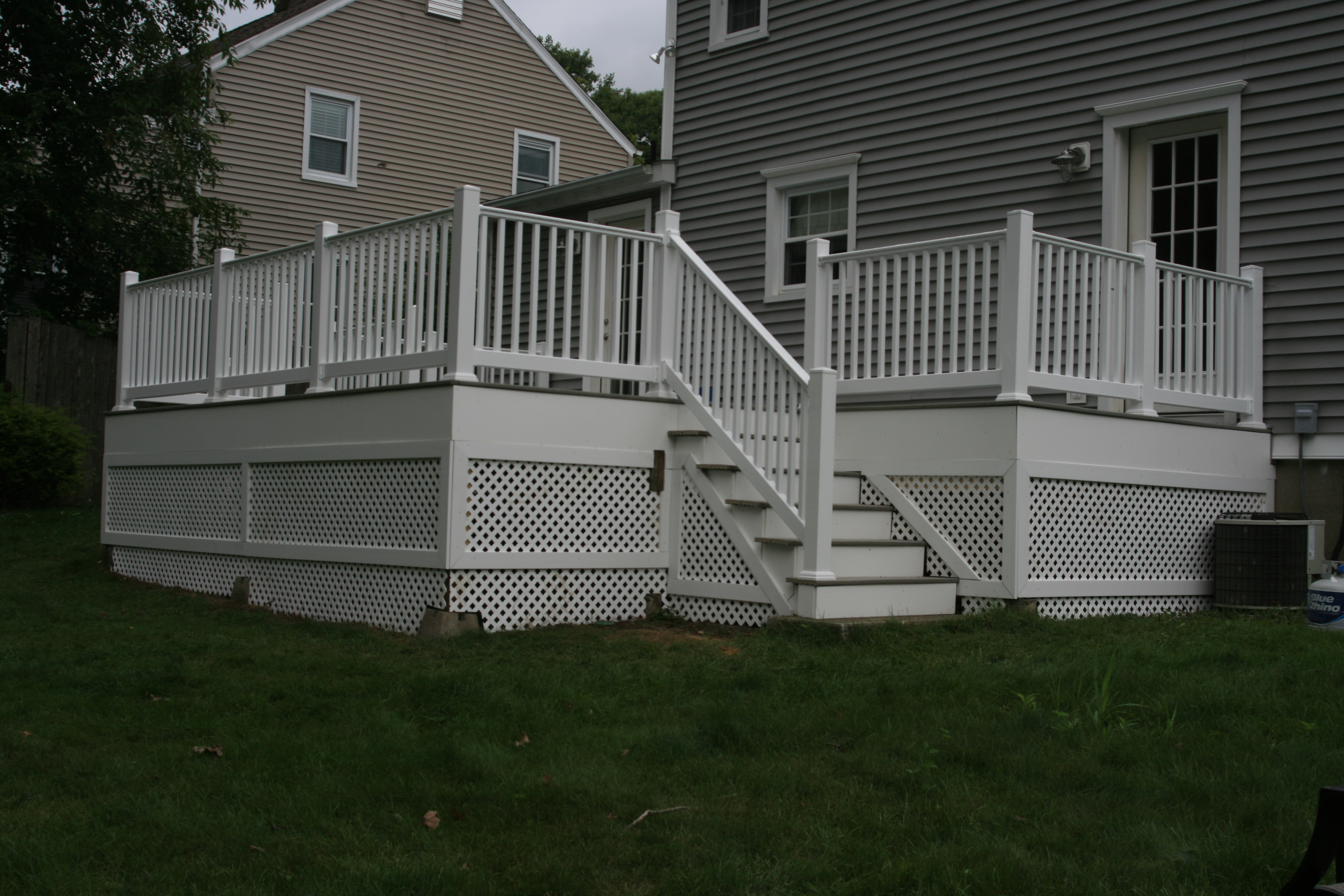 Refurbished deck with composite decking, railings, stairs and lattice work